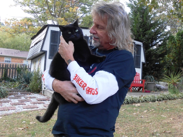 Jeff and Jumba in the back yard. Our fur kids are always glad to have us home.