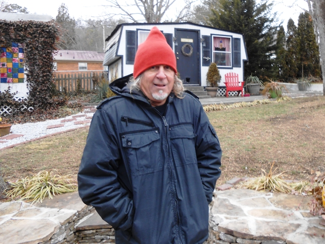 Jeff in the back yard after our day of riding. It's cold!