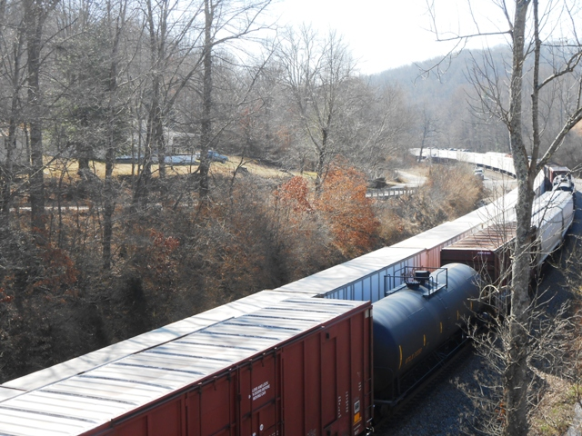 Cool view of train from bridge.