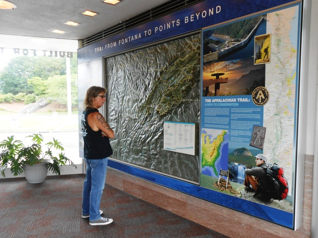 A series of maps and history of the dam inside the visitor center.