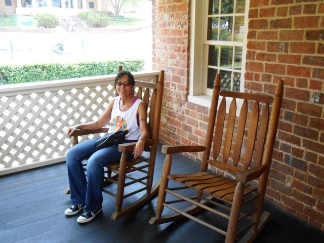 Pamo sitting on the back porch of Johnson's early home.