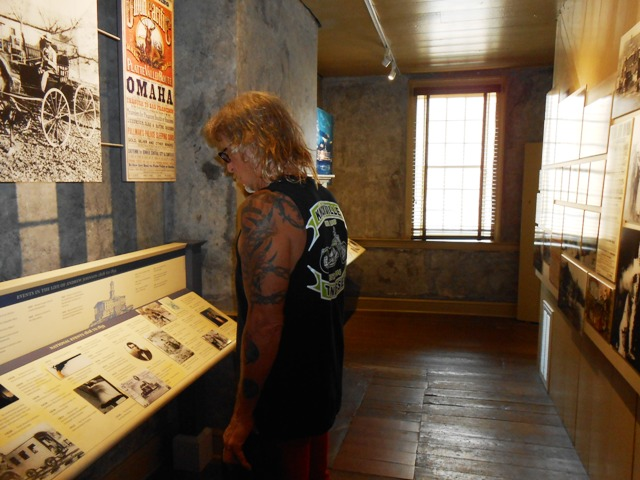 Jeff looking at the displays in Johnson's early home.