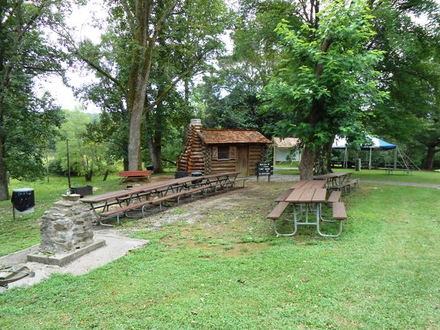 Long view of the replica cabin and surrounding area.