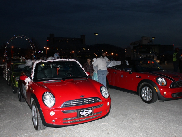 We are almost ready to go. Two convertible MINI's will lead the way.
