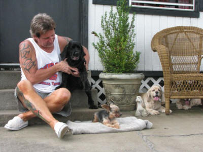 Jeff with all four of the dogs- Cindy, Shorty, Butter and Susie.