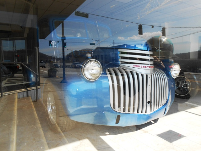 We looked at some antique cars in a downtown building.