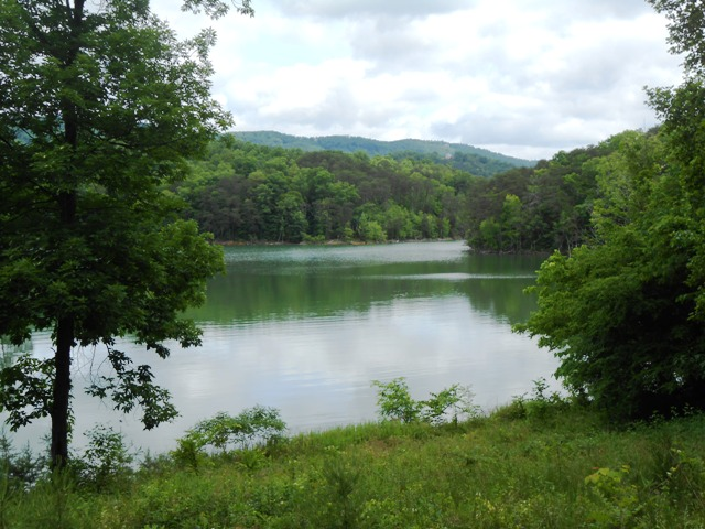 Norris Lake is visible from the road when the vegetation opens up.