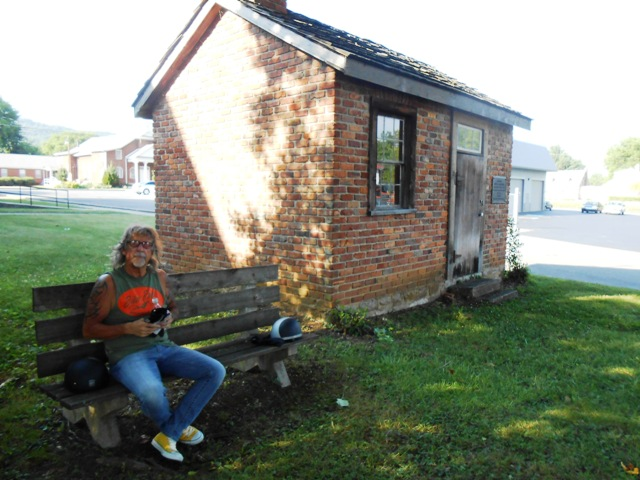 There's Jeff sitting on the bench next to the tailor shop. The building is a replica of the original shop.