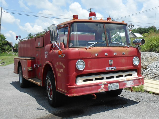 This nice vintage firetruck is parked across from the building with the MG's.