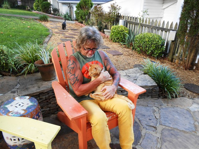 Jeff hugs on our cat Dave. The fur kids are always glad to have us home.