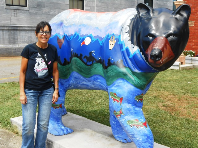 I get to stand by this beautiful bear painted by a local Indian tribe.