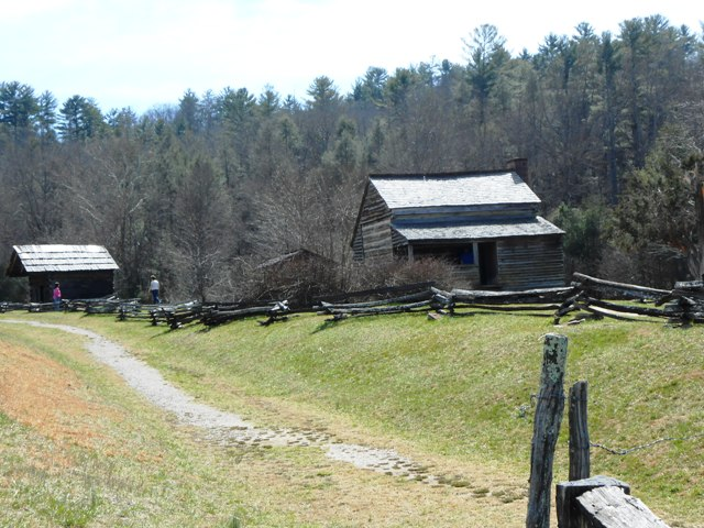 Visitors check out the historic cabins along the loop.