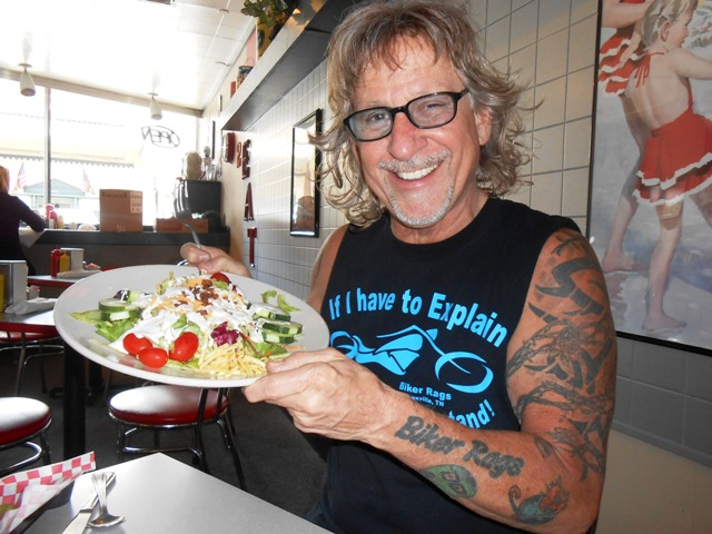 Jeff is laughing about the very LARGE salad he ordered.