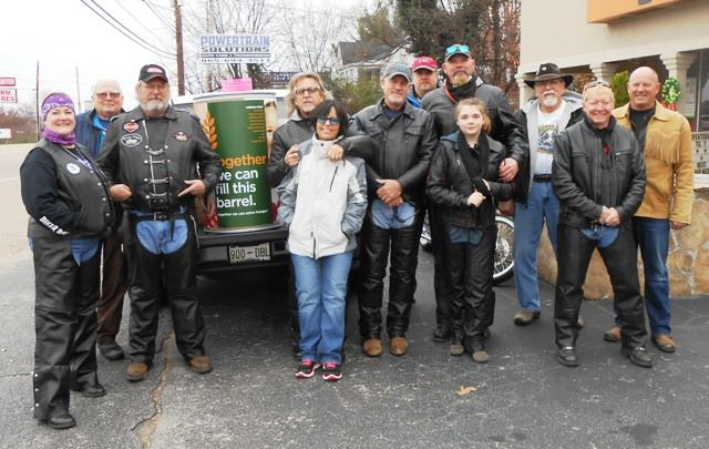 The terrific group of riders heading out to deliver the cans.