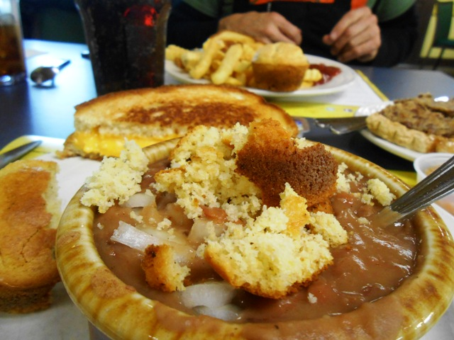 You can't go wrong with pinto beans and cornbread. Don't forget the onion and chow chow!